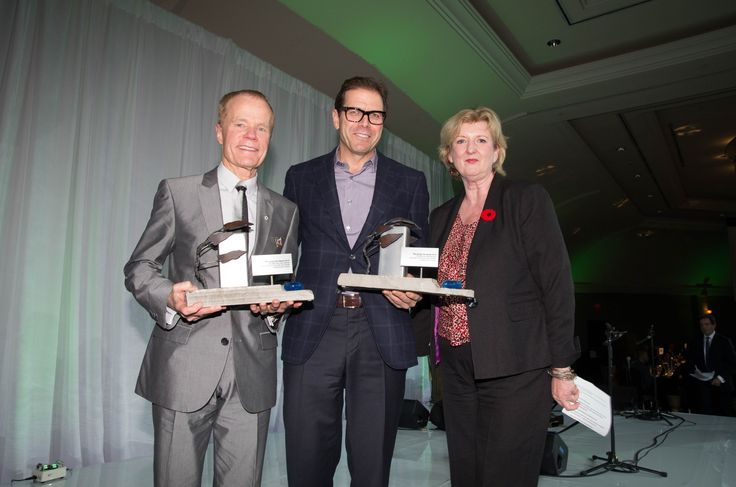 Peter Menkes of Menkes Developments and Bill Boyle of Harbourfront Centre with their Living City Award for the Nine Rivers and No Flat City exhibitions with the TRCA.