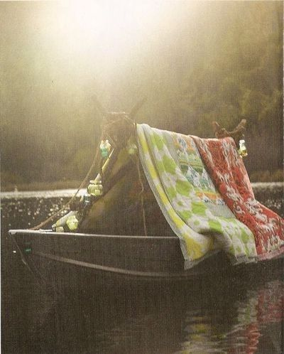 I dream of a pile of gorgeous old quilts, a boat, several soft pillows, and a river of dreams to float down.
