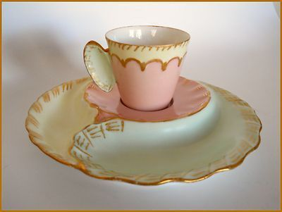 PLEASE LOOK AT MY OTHER AUCTIONS FOR MORE ANTIQUE HAND PAINTED PORCELAIN LIMOGES Here is a rare and unique Haviland Limoges Porcelain Cup/Saucer Set mold of the late 19th Century. In beautiful soft pa