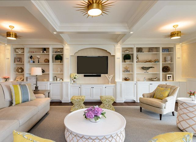 Family Room. Family room Design. Stylish family room with comfortable furniture, built-in and coastal decor. Built-in Paint color is Benjamin Moore White Dove OC-17. Walls are covered in a Phillip Jeffries Japanese paper weave grasscloth wallpaper. #FamilyRoom #FamilyRoomDesign #FamilyRoomDecor
