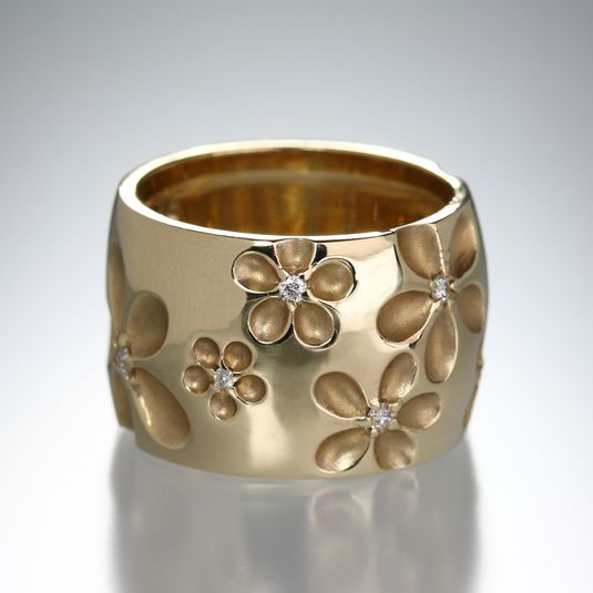 Wide Flower Band by Nicole Landaw. A 14k yellow gold.  wide engraved flower band with diamonds .