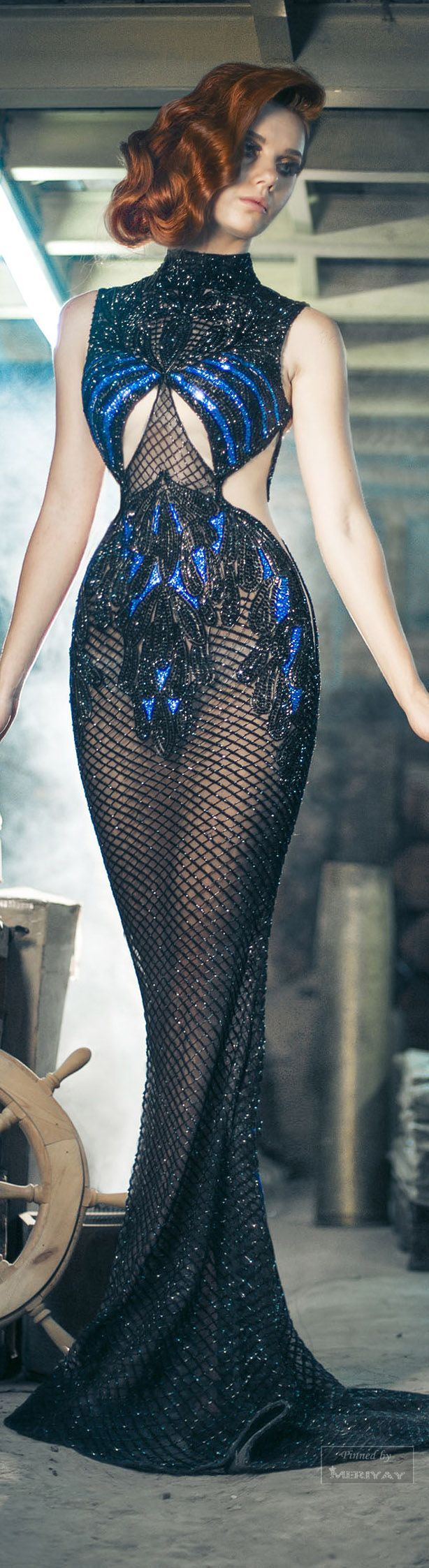 Charbel Zoe Fall-winter 2014-2015. EEEEK!! Looks like something out of science fiction. All of this designer's gowns are weird, flesh-baring things like this.