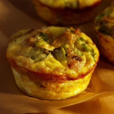 Mini Mushroom and Sausage Quiches ~ These crustless mini quiches are like portable omelets. Turkey sausage and sautéed mushrooms keep them light and savory. Small and satisfying, they're a great finger food for your brunch.