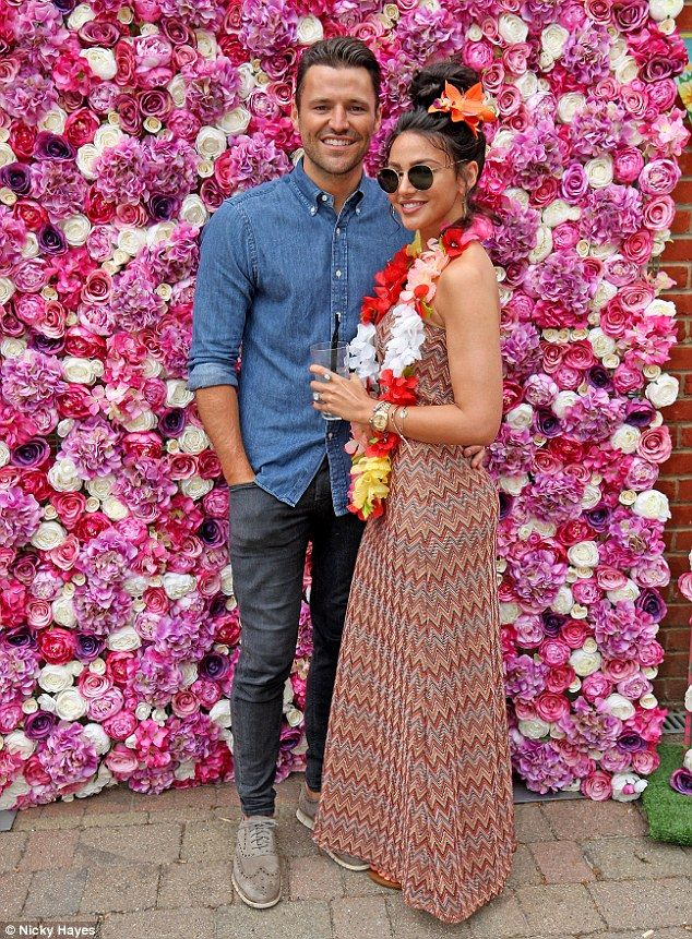 Loved up: Mark Wright and Michelle Keegan, both 30, looked loved up as they donned Hawaiian themed outfits for Mark's sister Natalya's 17th birthday on Sunday