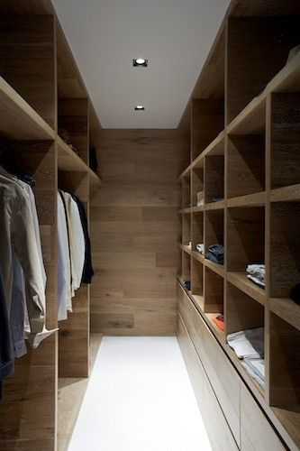 Modern wardrobe closet with pretty organizing solutions.