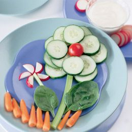 Vegetable Flowers with Homemade Ranch Dip- can add shredded lettuce or any green for grass, orange or grapefruit for sun, can add my cut melon boat with apple peal umbrella