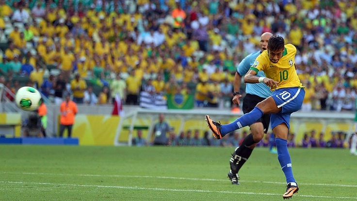 FORTALEZA, BRAZIL - JUNE 19: Neymar of Brazil scores the opening goal during the FIFA Confederations Cup Brazil 2013 Group A match between Brazil and Mexico at Castelao on June 19, 2013 in Fortaleza, Brazil. (Photo by Clive Rose/Getty Images)