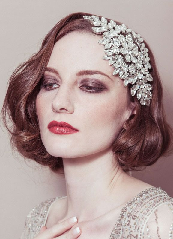 it's not a dress, but that art deco hair accessory is simple beautiful and would look great with short hair like in the pic.