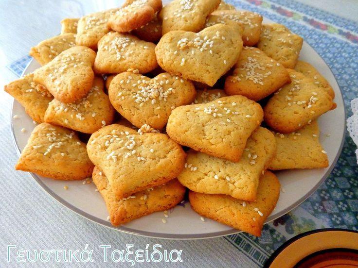 ΠΑΡΑΔΟΣΙΑΚΑ ΚΟΥΛΟΥΡΑΚΙΑ ΟΥΖΟΥ ... :) ! Mοσχομύρισε τό σπίτι ούζο καί γλυκάνισο ... ! ! ! ΠΡΟΕΤΟΙΜΑΣΙΑ: 45' ΧΡΟΝΟΣ ΜΑΓΕΙΡΕΜΑΤΟΣ: 12 μέ 15' YΛΙΚΑ: 1/2 φλυτζάνι ελαιόλαδο 1 φλυτζάνι ζάχαρη 2 αυγά 1 φλυτζανάκι ούζο 1 κ.