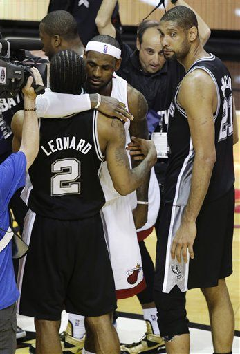 "The King hugging Kawhi Leonard ""Young Superstar"". While ""Cool Man"" Duncan looks on."