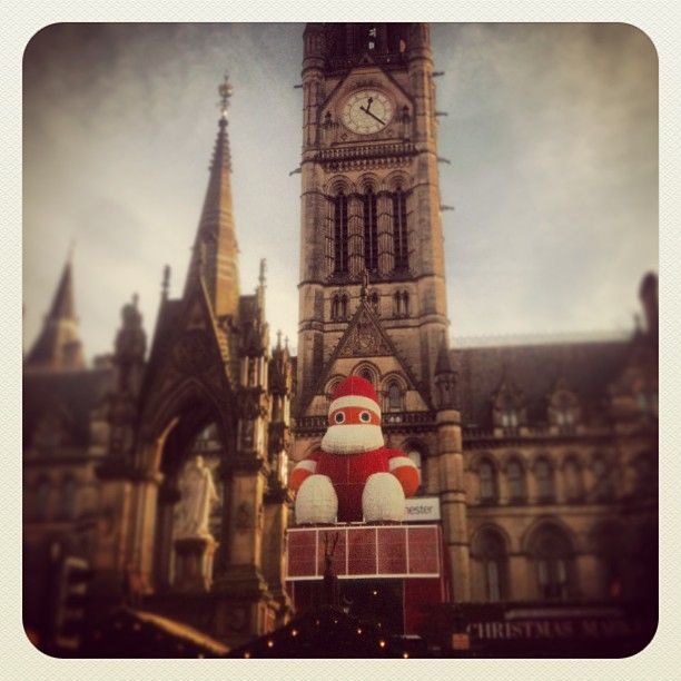 Santa sat outside the beautiful Manchester Town Hall watching over the Christmas Markets