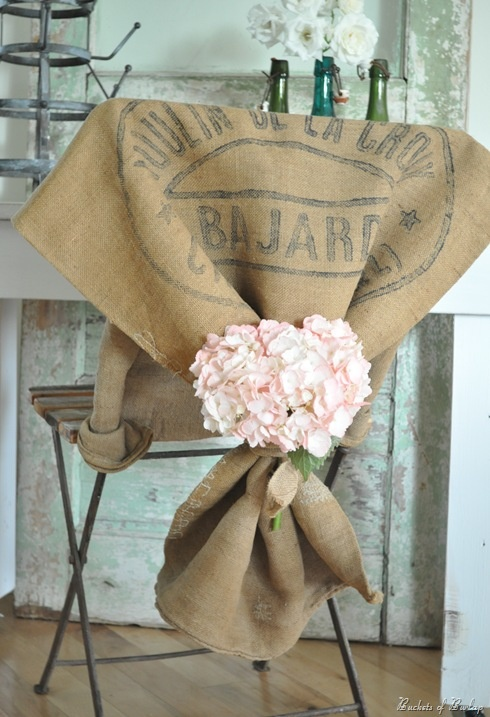 Grain sacks and pink hydrangeas, a lovely combo for seating at a wedding, rehearsal dinner, baby shower or spring gathering.
