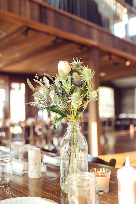 I love how this looks like someone just got an old bottle and placed flowers from the field! ((rustic wedding flower arrangements)