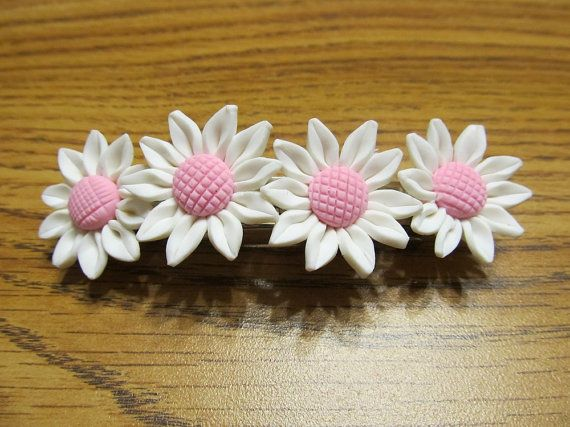 This is a handmade beautiful white polymer clay sunflower hair barette. There are four flowers on the clip. The flowers are approximately 30mm diameter