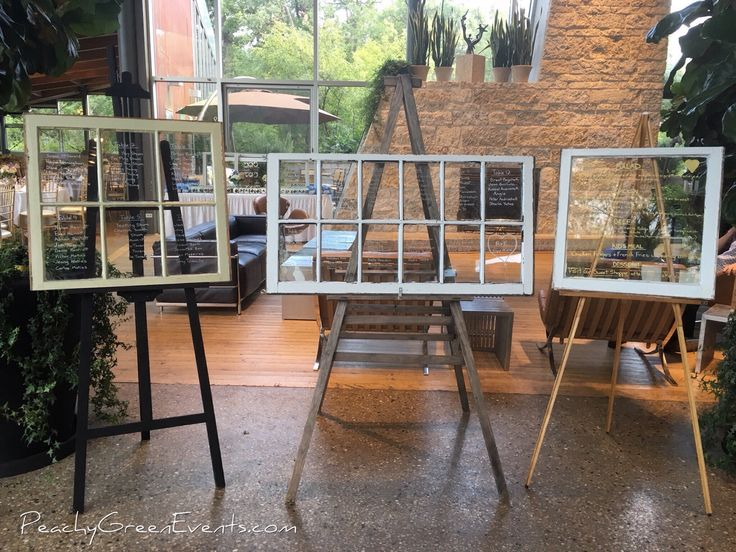Vintage windows on rustic and vintage floor easels for wedding seating charts for a wedding at Qualico Family Centre in Winnipeg