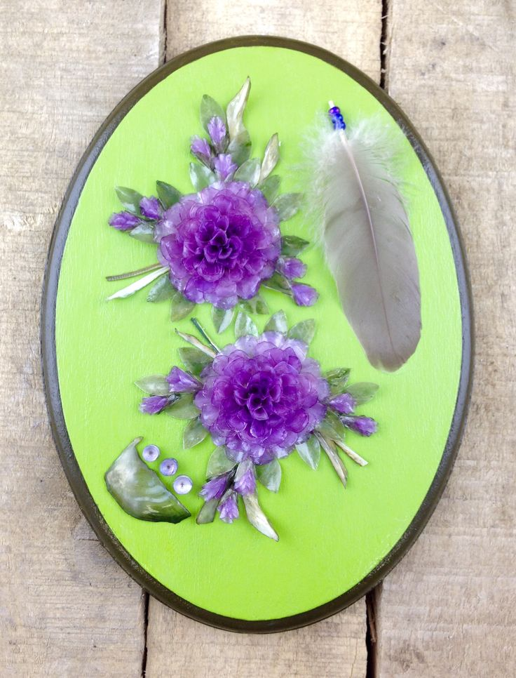 Every scale in this gorgeous, Green/Purple-themed Fish scale wall hanging was individually hand-dyed and meticulously arranged to create this exquisite piece of art. This piece in particular also features a mini feather. #Esawa #FishScaleArt #Handmade #Feather