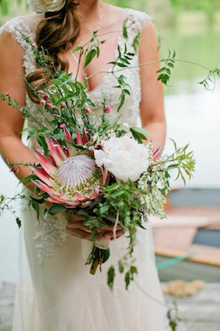Protea wedding bouquet | Kristyn Hogan Photography | see more on: http://burnettsboards.com/2014/09/rustic-refined-driftwood-wedding-inspiration/