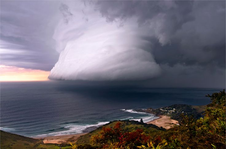 Australian Weather Calendar 2013 / July: A squall line associated with a thunderstorm over Era Beach, south of Sydney.  Picture: Bruce Cooper  wouldn't that be scary if you're on the water