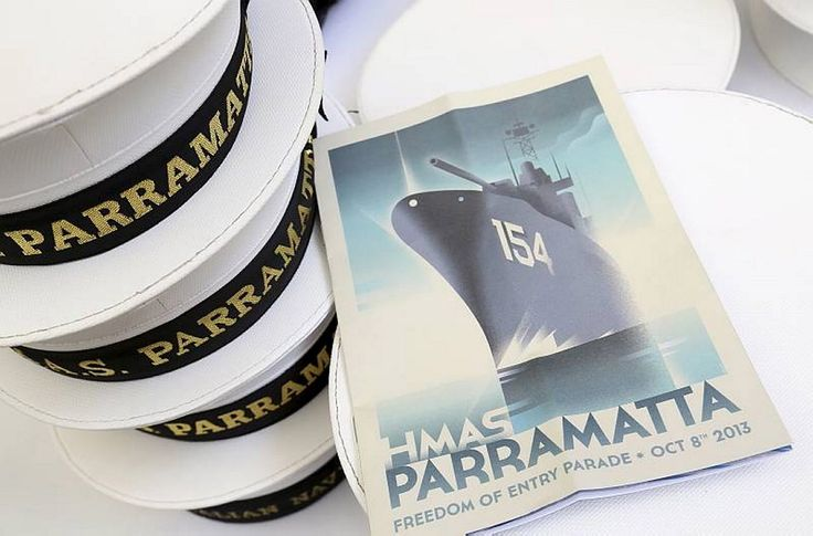 HMAS Parramatta sailors hats with the program from the Freedom of Entry march at the official civic reception hosted by the Parramatta City Council.