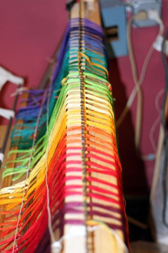 rainbow warp on the loom