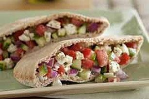 GREEK PITA POCKETS  Prep time: 10 min  Total time: 10 min  Makes: 6 (2 pita halves each)  What You Need  1 pkg. (4 oz.) ATHENOS Crumbled Feta Cheese with Garlic & Herb 3 cups chopped cucumber 1 cup chopped red onion 1 cup chopped tomato, drained 2 Tbsp. lemon juice 6 whole wheat pita breads, halved  Make It  Mix all ingredients except bread. Spoon about 1/2 cup of the cheese mixture into each pita bread half.