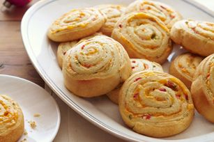 Pimento cheese pinwheels...ooh I bet Whole Foods homemade pinto cheese would be awesome in this!
