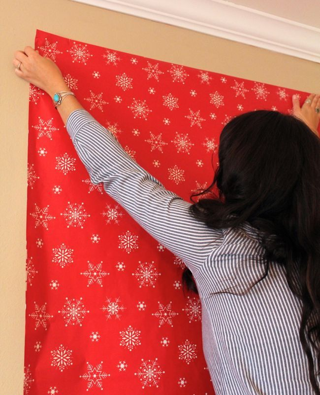 wrapping paper would be the easiest way to act as a backdrop plus theres more christmas photobooth backdropdiy