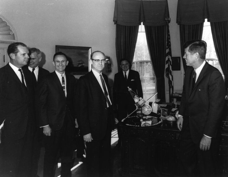 Dr. William H. Pickering, (center) JPL Director, presenting Mariner spacecraft model to President John F. Kennedy, (right). NASA Administrator James Webb is standing directly behind the Mariner model. The Mariner 2 probe flew by Venus in 1962 after the failure of Mariner 1, sending back data on its atmosphere, mass, and weather patterns. It stopped transmitting in 1963 after delivering a wealth of scientific information. (Great Images in NASA)