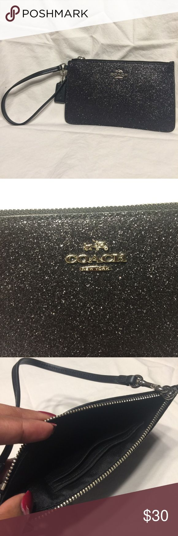 Black glitter Coach wristlet New, only used once, black glitter coach wristlet. Bought it at the Coach store in New Orleans to take into a NFL game because my cross-body was too big. Great condition, just don't have a use for it. Coach Bags Clutches & Wristlets
