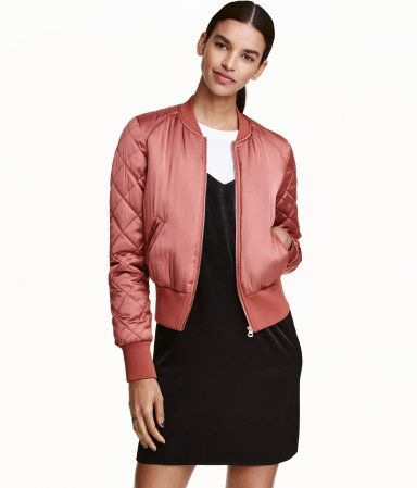 Dark dusty rose. Padded bomber jacket in woven satin fabric. Front zip, mock side pockets, and quilted sleeves. Ribbing with a slight sheen at neckline,