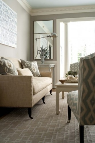 Love the nailhead detail against the linen fabric on the couch + the muted gray fabric on the chairs and toss pillows