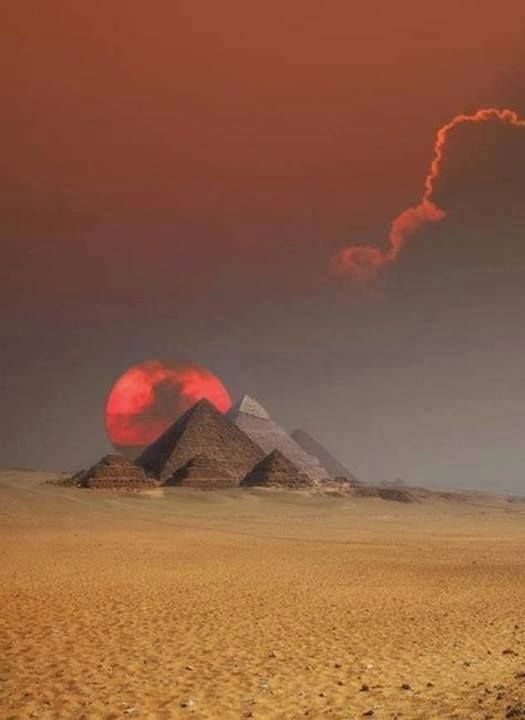 the pyramids of gizah in cairo, egypt, at sunset