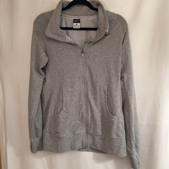 Nike women's zip up - size large Gray Nike Dri Fit size large zip up. Super comfy!!! Sleeves have thumb holes. make me an offer :) Nike Jackets & Coats