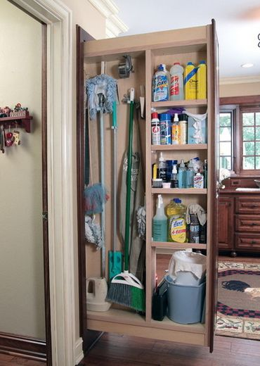 PULLOUT BROOM CLOSET - Between washer/dryer and coat hook cabinet