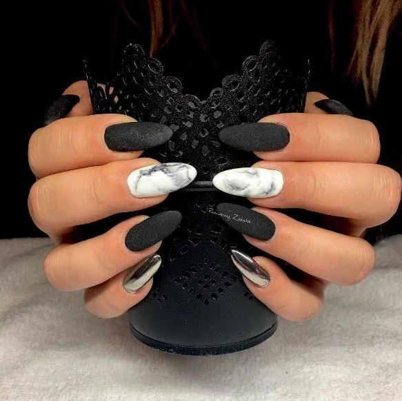 These marble matte black and silver chrome nails are super edgy. I love the almond shape of them too!