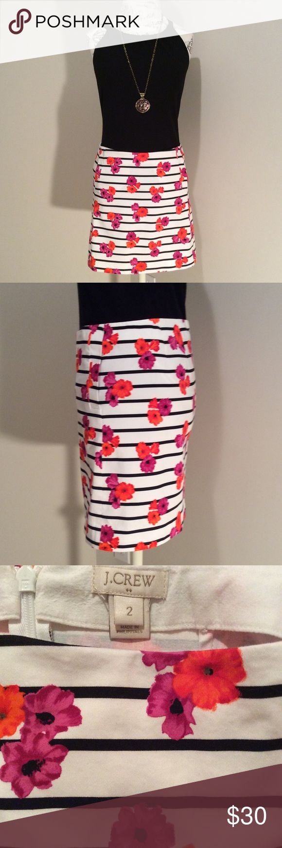 J Crew Factory mini skirt White mini skirt with black horizontal stripes and pink and orange flowers.  Two side pockets. Zips at the back.  Worn only 2-3 times.  Like new.  (Shown with back top, not for sale) J. Crew Factory Skirts Mini