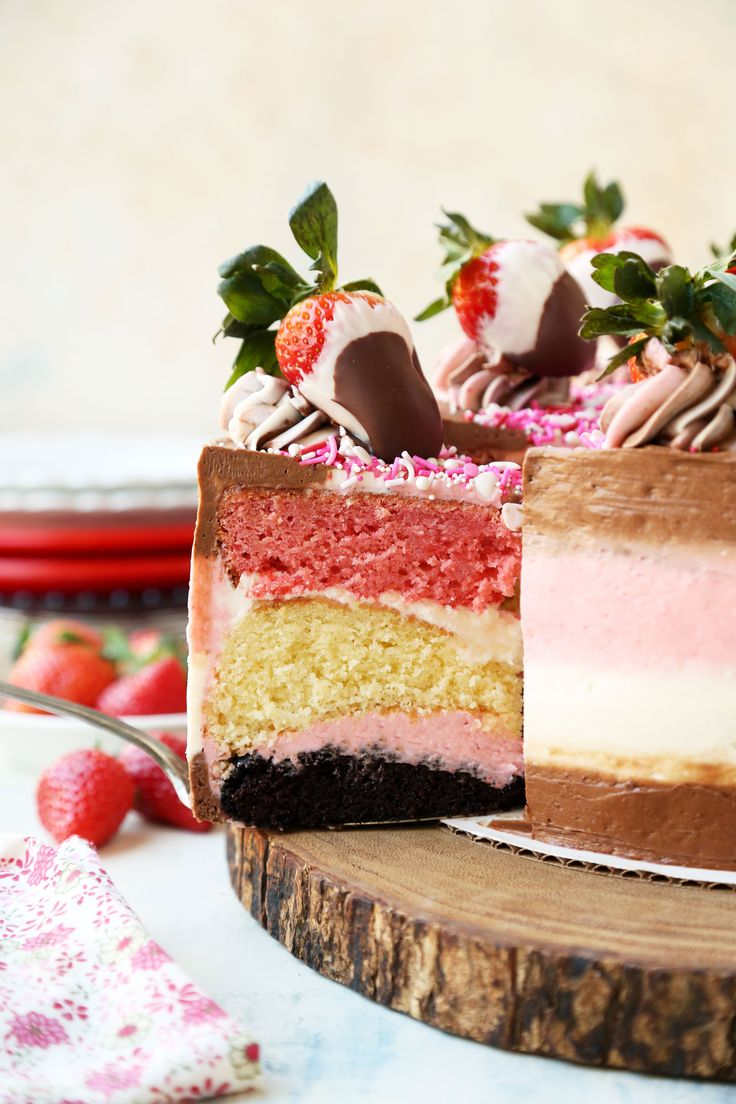 Chocolate-Dipped Strawberry Neapolitan Cake is the ultimate Valentine's Day Cake and the perfect way to show your loved one just how much you care for them!