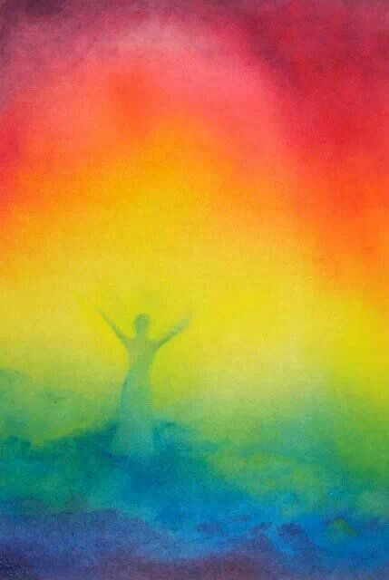 Rainbow color mist and woman praising the Lord.