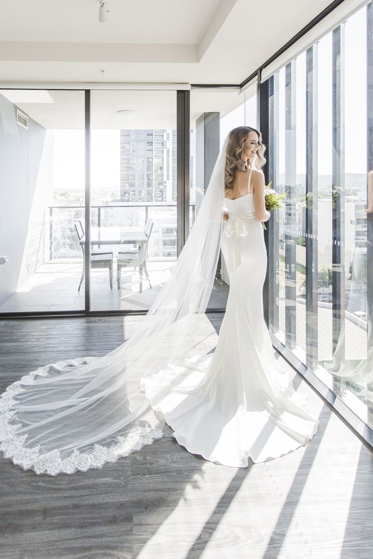 How stunning the Jess look in our White Arianna dress?! The elegant floor length gown, by Elle Zeitoune, is a flattering strapless style featuring a sweetheart neckline with satin waistband and floor sweeping train. The dress also comes in Blush, Navy and Nude.