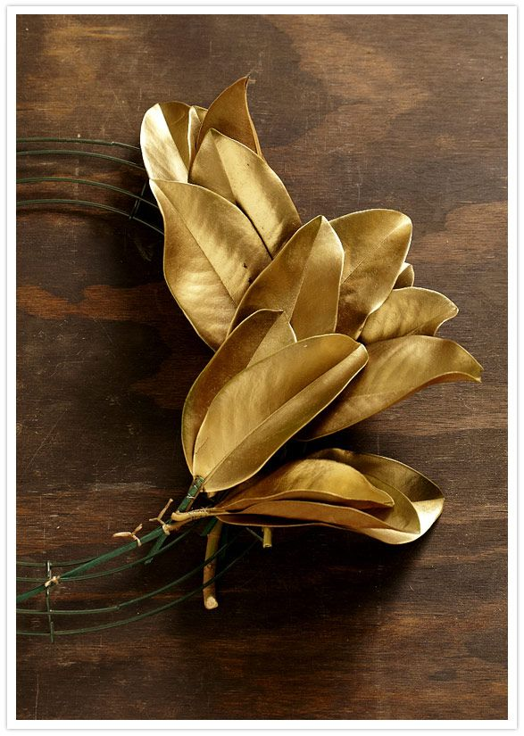 diy holiday magnolia wreath - leaves sprayed antique gold and wired to a frame