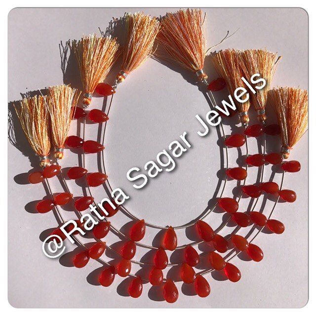 Carnelian Gemstone - Flat Pear Briolette in micro cut from indian mines, AAA grade translucent , red-orange colors in sizes 6-8 to 10-12 mm graduated strands for variations in #jewellery designs available at http://www.ratnasagarjewels.com/wholesale-carnelian-gemstones.html #gemstonebeads #gemstonejewelry #gemstonewholesale #beads #gemstone #wholesalebeads #天然石 #宝石 #天然石ビーズ #gemstonenecklace #quartz #gemstones #loosegemstonebeads #fashion #amethyst #tourmaline #citrine #peridot #rosequartz