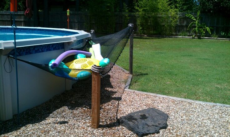 Above ground pool toy caddy.  Toys can be reached from in the pool.