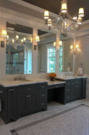 The master bath in the Southern Living Showcase home: I like the black cabinets and tiles and chandelier!