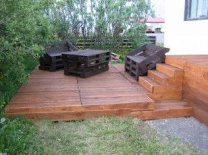 Wooden deck made out of second-hand pallets. Added few planks to cover the holes and painted 2 to 3 times with wood oil. Love this! :D