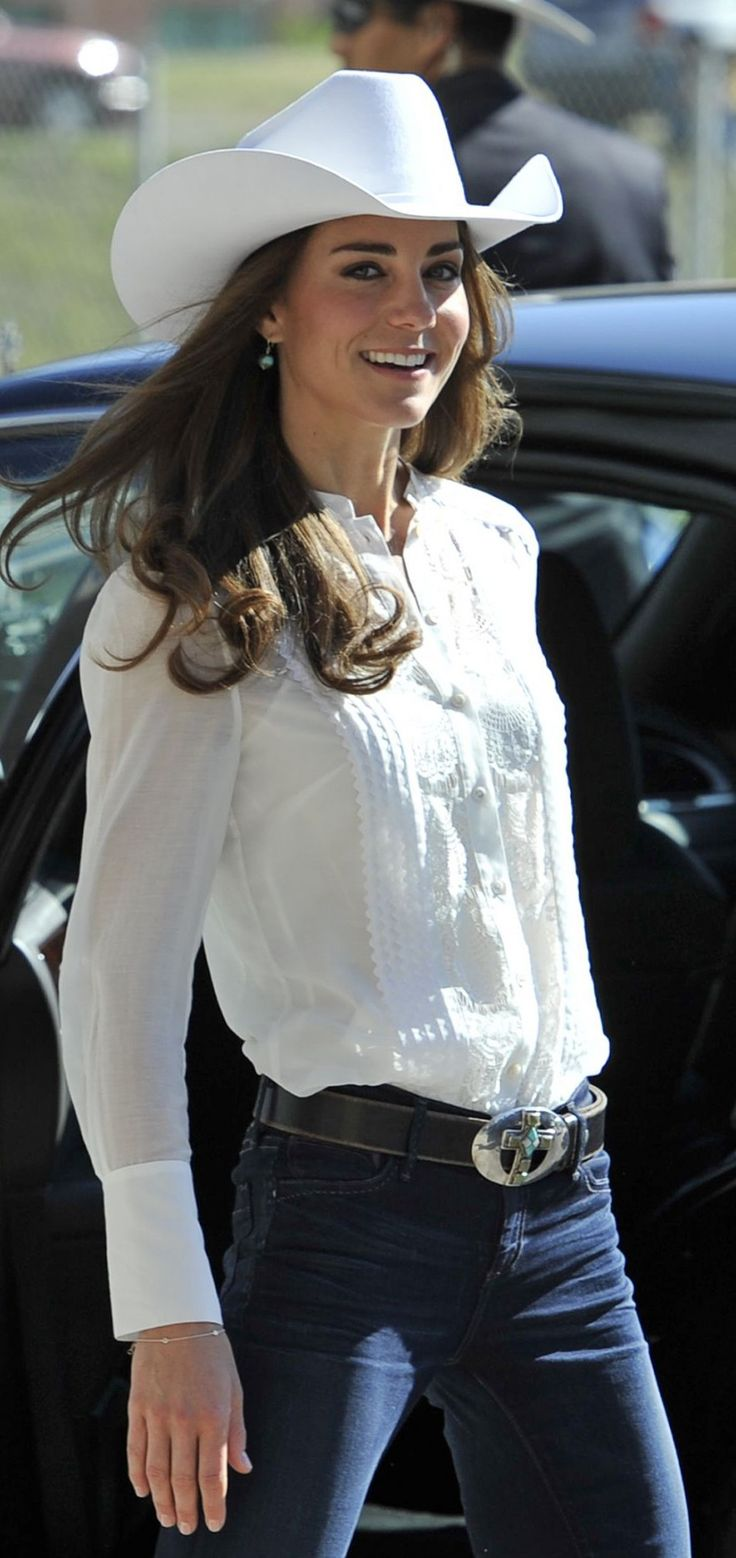Kate Middleton, Duchess of Cambridge, leaves after watching the beginning of the Calgary Stampede parade in Calgary, Alberta, July 8, 2011.