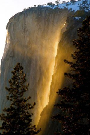 Horsetail Falls, Yosemite National Park. This is a natural phenomena where the setting sun hits the mist of the falls at the perfect angle. This only happens once a year.