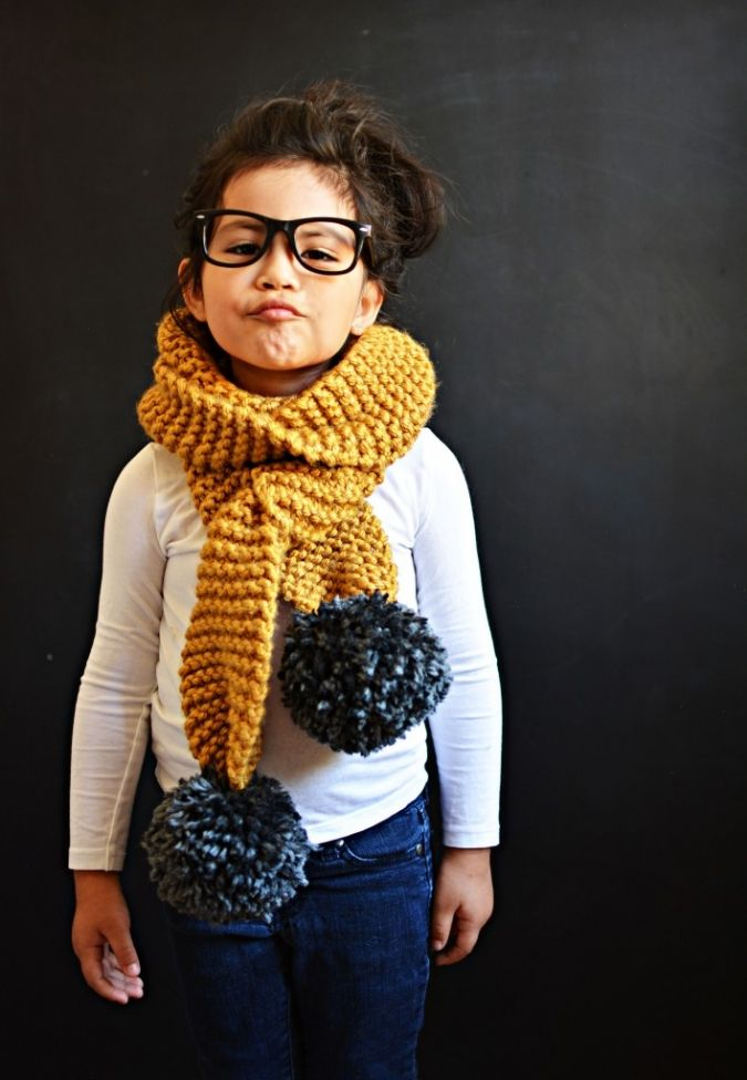 Knitted Pom Pom Scarf Tutorial | You'll need 3 chunky yarn skeins and a 13 size…
