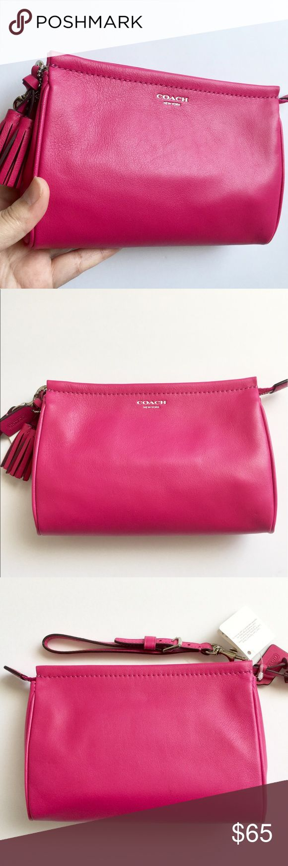 Coach Legacy leather large wristlet Coach Legacy leather large wristlet. Style# 48025, Silver/Fuchsia. Note: It is a soft leather with indentation on the back corner of wristlet, as seen in the last photo. Coach Bags
