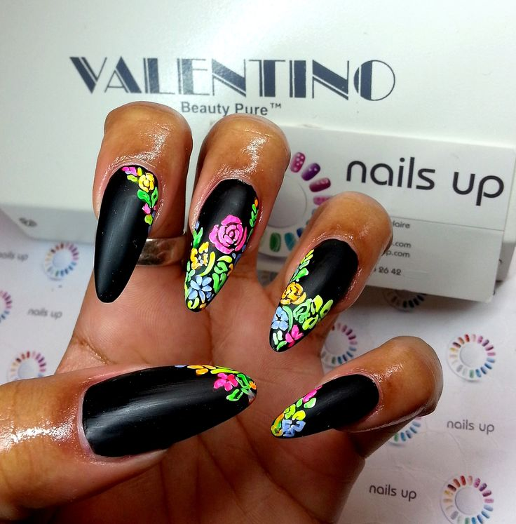 ✦✨✦ black stiletto nails with floral nail art.