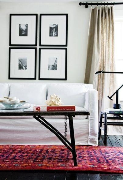 Black Wood Floors Linen Drapes Crisp White Sofa Colorful Rug Accents